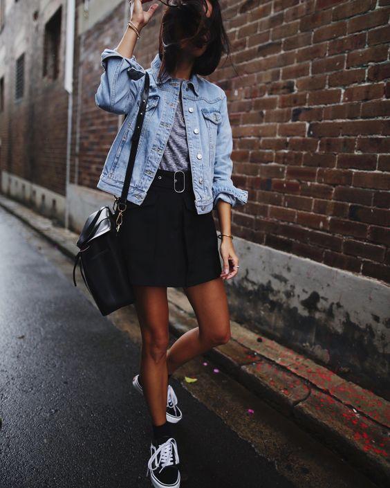 a grey tee, a denim jacket, a black mini and black Vans