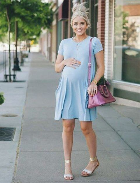 a pastel blue dress with short sleeves, ankle strap sandals and a pink bag