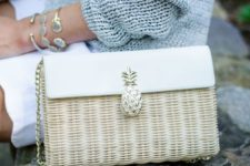 06 a straw and leather neutral bag with a pineapple detail is a cute summer piece