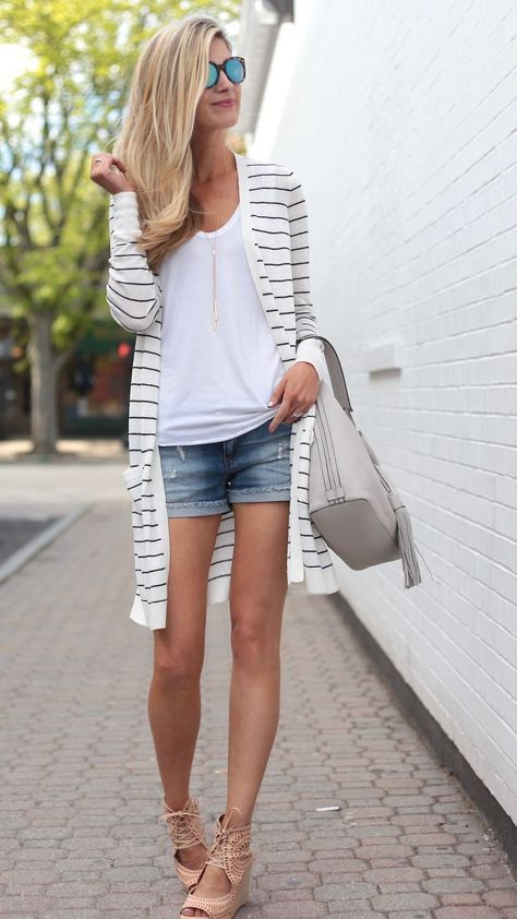 a white top, denim shorts, a long striped cardigan and blush laset cut lace up shoes
