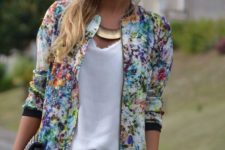06 ripped denim shorts, a white top, a colroful floral print bomber jacket and a clutch