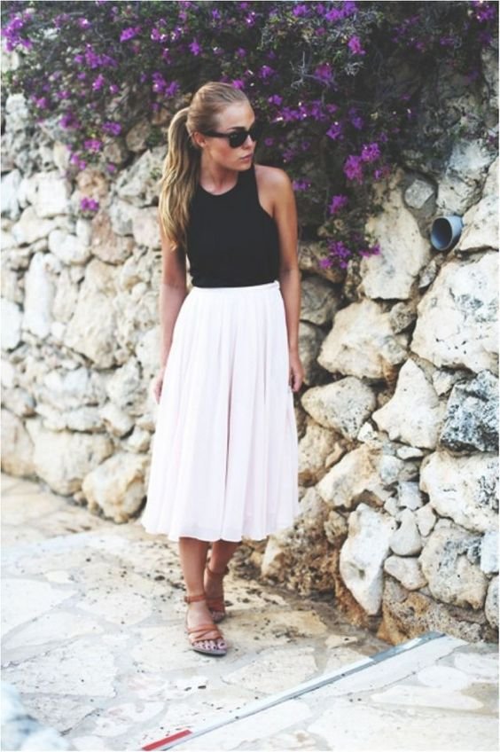 a blush midi skirt, a black haltern neckline top and brown strappy sandals