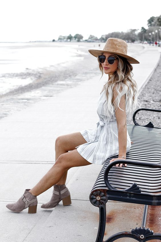 a light striped mini dress and grey suede boots in case it rains