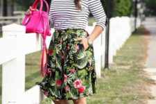 07 a tropical print knee skirt, a striped black and white long sleeve, neutral heels and a hot pink bag