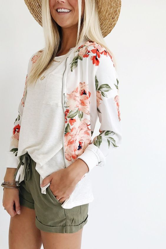 olive green shorts, a white t-shirt, a white floral print bomber jacket and a straw hat for summer