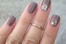 07 rounded taupe nails with gold glitter touches