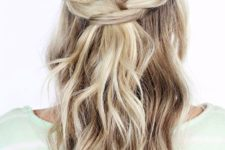 08 a half updo with twists and loose waves down is ideal for hot and humid weather