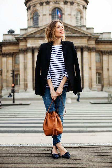 a striped longsleeve, a black blazer, blue distressed jeans and black textural flats