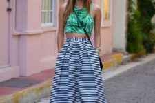 08 a tropical leaf print haltern neckline crop top, a black and white striped midi skirt and black heels