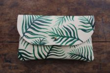08 a white leather lutch with a fern print is ideal for summer