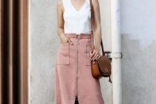 08 a white strap top, a pink zip skirt with pockets and white shoes