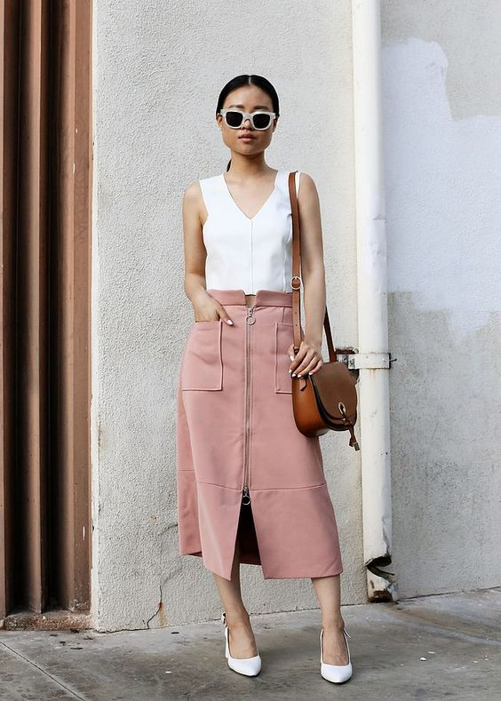 a white strap top, a pink zip skirt with pockets and white shoes