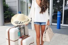 08 mini denim shorts, a white top, a white cardigan and grey suede booties