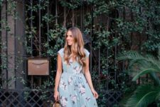 09 a blue maxi dress with a pink floral print, heeled sandals and a straw bag