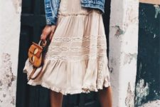 09 a blush knee dress with ruffles and white lace detailing with a denim vest and lace up shoes