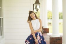 09 a white halter neckline top, a navy floral print skirt and pink rain boots