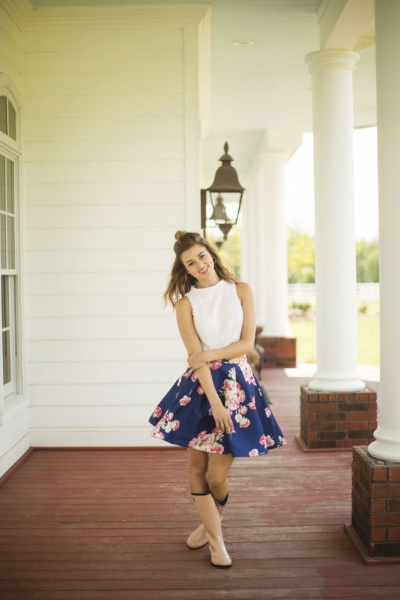 a white halter neckline top, a navy floral print skirt and pink rain boots