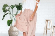 09 a white off the shoulder top, a blush midi skirt with a button row and strappy white heels