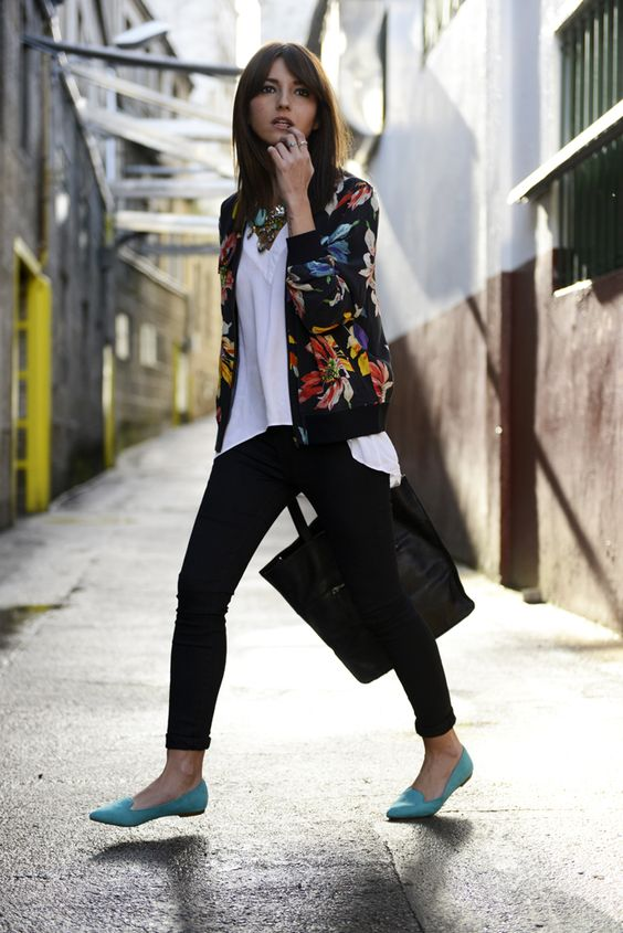 black cropped jeans, a white tee, a black bomber jacket with a bold floral print and turquoise flats