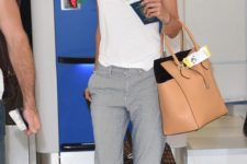 09 comfy grey pants, a white top, neutral moccasins and a hat is a great no fuss outfit