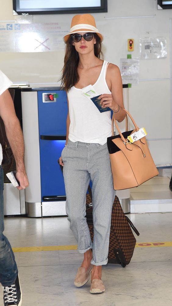 comfy grey pants, a white top, neutral moccasins and a hat is a great no fuss outfit