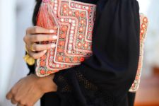 10 a bold orange clutch with beading, sequins and tassels screams citrus