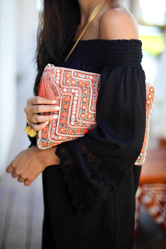 a bold orange clutch with beading, sequins and tassels screams citrus