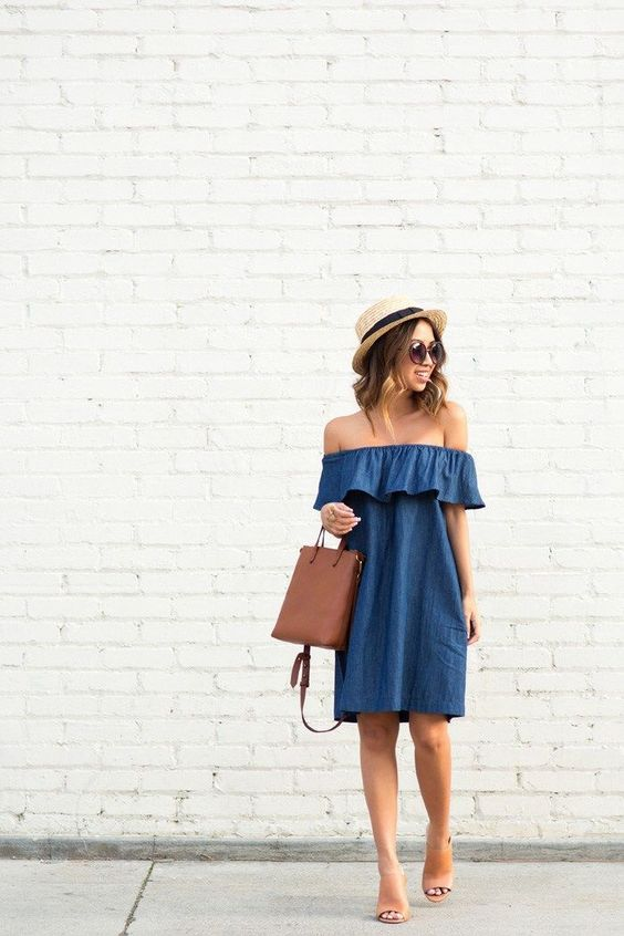 a chambray off the shoulder dress, brown leather shoes and a leather bag