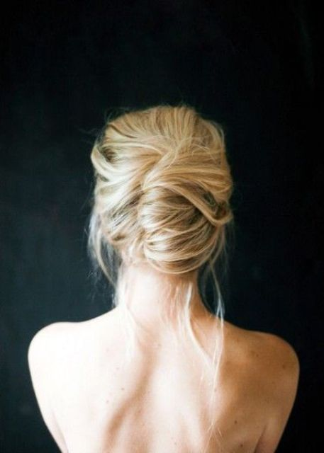 a loose and messy summer updo with some hair down