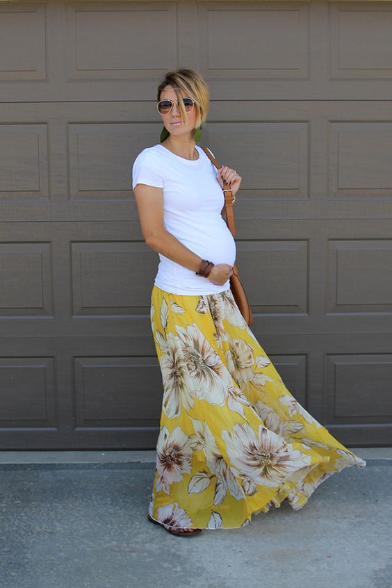 a white tee, a floral maxi skirt and a brown leather bag is all you need
