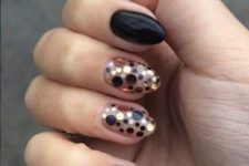 10 black rounded nails with accent polka dot nails in gold, copper and black