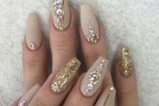 10 matte nude nail art with gold glitter, gold stripes and rhinestones