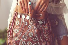11 a brown leather boho bag decorated with beads, embroidery and coins