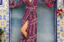 11 a burgundy and white printed wrap dress with long bell sleeves, a V neckline and a front slit