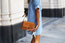 11 a chambray mini dress, sneakers and a brown leather bag