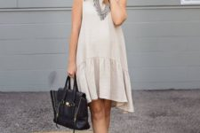 11 a neutral drop waist dress without sleeves, black leather peep toe booties and a matching tote
