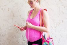 11 a textural pink strappy top, black leggings and a colorful printed bag