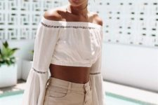 11 high waisted beige shorts with a button row, a white off the shoulder boho lace crop top with bell sleeves