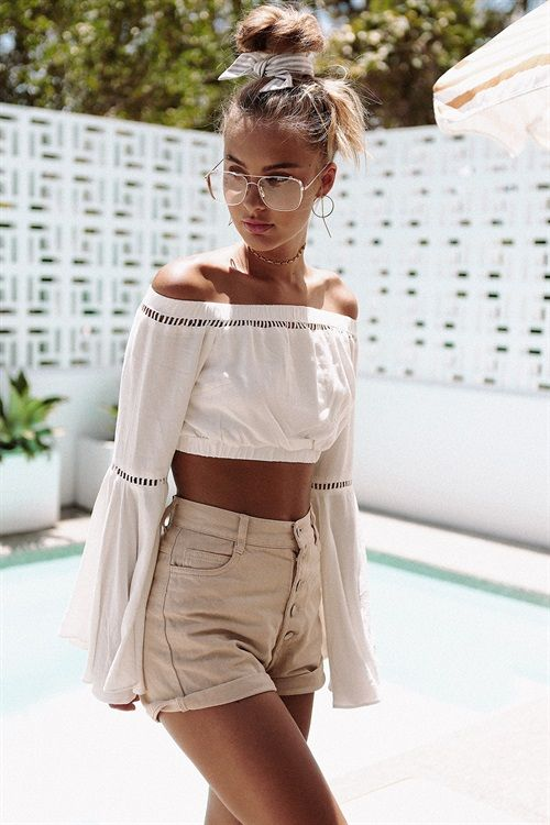 high waisted beige shorts with a button row, a white off the shoulder boho lace crop top with bell sleeves