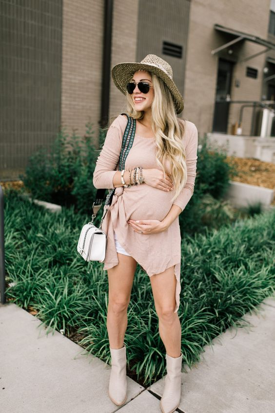 a blush dress with an asymmetric edge, white denim shorts, blush suede boots and a smal white crossbody