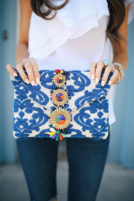 a bold beaded embroidered clutch with gems of all colors