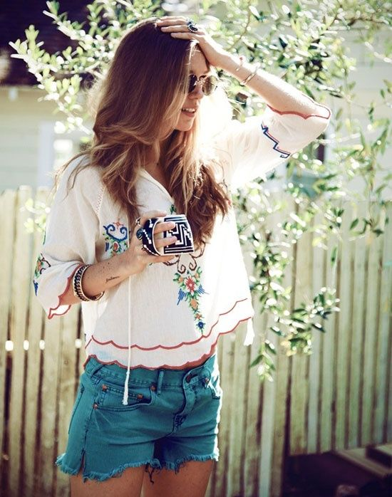 a colorful embroidered shirt with a trim, denim shorts is all you need