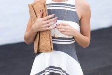 12 a grey and white striped halter neckline A-line dress and a neutral clutch