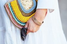 12 a half circle clutch with colorful beads and sequins is great for a neutral summer outfit