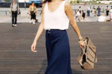 12 a navy midi skirt, a white strap top and comfy heels