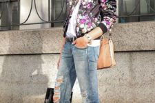 12 distressed jeans, a white lace top, a black floral print bomber, a neutral bag and laser cut flats