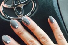 12 grey nails with polka dots and small hearts for accents