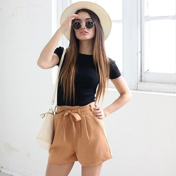 high waist bow amber shorts and a black tee, a hat and a neutral bag for a boho-inspired look