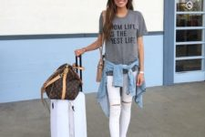 12 white ripped jeans, a grey printed tee, white moccasins and a denim jacket for a casual look