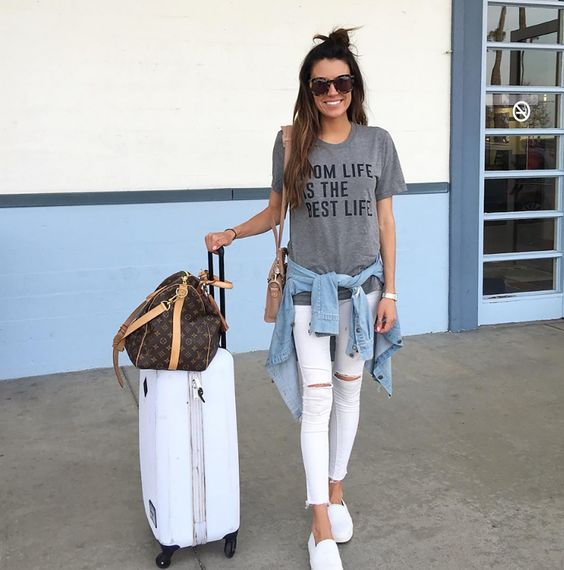 white ripped jeans, a grey printed tee, white moccasins and a denim jacket for a casual look